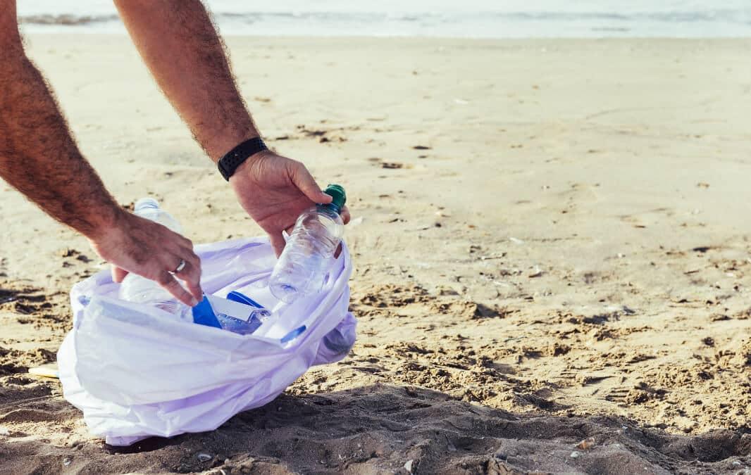 Picking plastic bottles at the beach